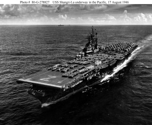 USS Shangri-La (CV-38) underway in the Pacific, crew paraded on flight deck, 17 August 1945, just after V-J Day. U.S. Navy photo.