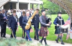 Kyle and Lauren Gaul, Pipe and Drum, followed by VFW Post 1040 Color Guard