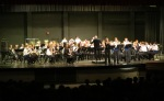 "Symphonic Band (88 members) accompanies the trumpet trio in ""Bugler's Holiday"""