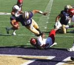 Cyler Miles, UW, scores against Eastern Washington University Eagles