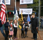 Glenn Ledbetter organizes Girl Scout Color Guard before ceremony begins. Photo by David Pan, Editor, Lynnwood Today.