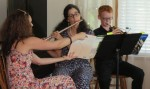 """Mom plays duet with son, """"Minuet"""" by Johann Sebastian Bach"""