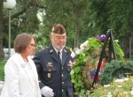 Myra Rintamak, escorted by Frank Martinez, lays the Gold Star Mothers' Wreath