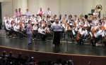 Kelly Barr-Clingan conducts combined band and orchestra and Banda Vagos