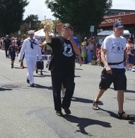 Glenn Ledbetter blows kiss to daughter at Edmonds Independence Day Parade, 2017