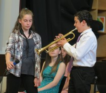 "6th-grade trumpeter takes solo during ""Louie, Louie"""