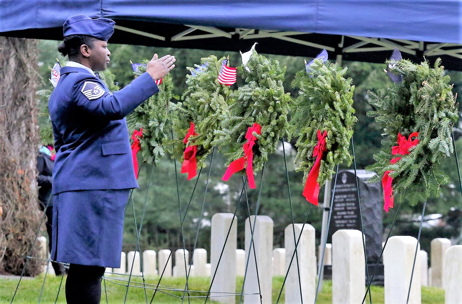 Air Force Master Sgt. Shanda De Anda salutes the wreath on which she just placed a flag (2)