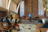 Scott D'Angelo, LIYH Seattle Director, opens the Spring Recital in Woodland Park Presbyterian Church in Seattle