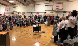 Veterans in attendance (center background)