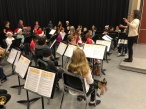 """Jane Lin, percussion instructor, conducts """"Hot Cross Buns,"""" played by the percussion section"""