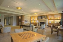 University-House-Issaquah-senior-living-interior-fireside-lounge-with-game1[1]