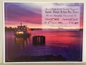 "Certificate, signed by the Spokane's Captain, officially recording the time and place that Joe Doyon's cremated remains were ""Respectfully Delivered to the Sea."""