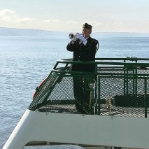 "Aboard the ferry, Spokane, Glenn Ledbetter plays ""The Navy Hymn"""