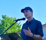 Feliks Banel of KIRO-FM Radio, emcee of the re-dedication ceremony